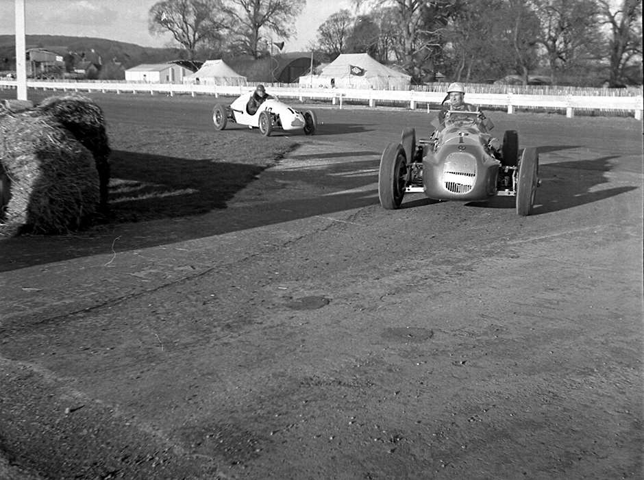 1951 Easter Monday Goodwood - Young Moss drives into the paddock in his Formula 2 HWM