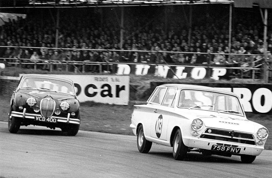 Times change - Lotus-Cortina grips, Jaguar doesn't... Saloon cars GPL