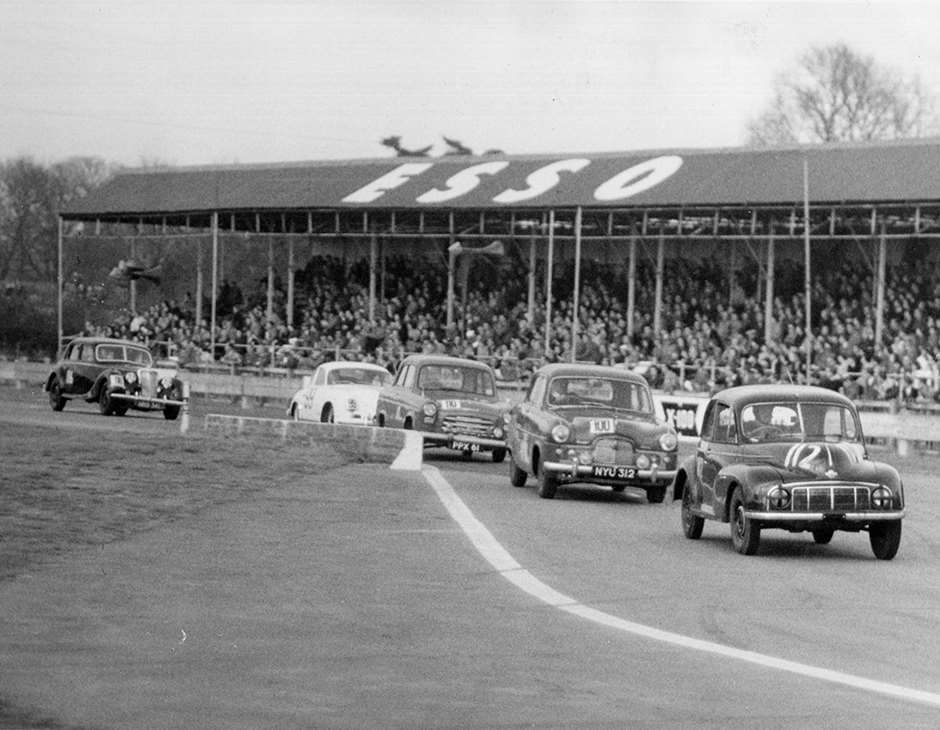 An heroic Morris Minor MM leading the assorted pack, Ford, Hillman (???), Porsche, Riley in the chicane - GPL Saloon cars