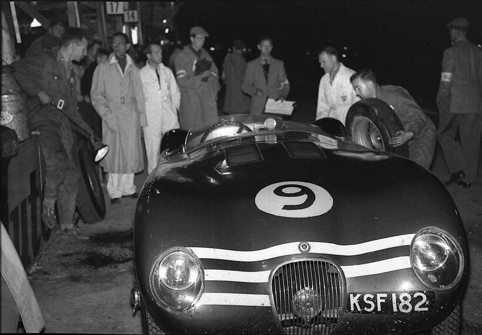 Pit lane illumination does the job for the Jock Lawrence/Frank Curtis Ecurie Ecosse Jaguar C-Type, 1953 Goodwood 9-Hour race.