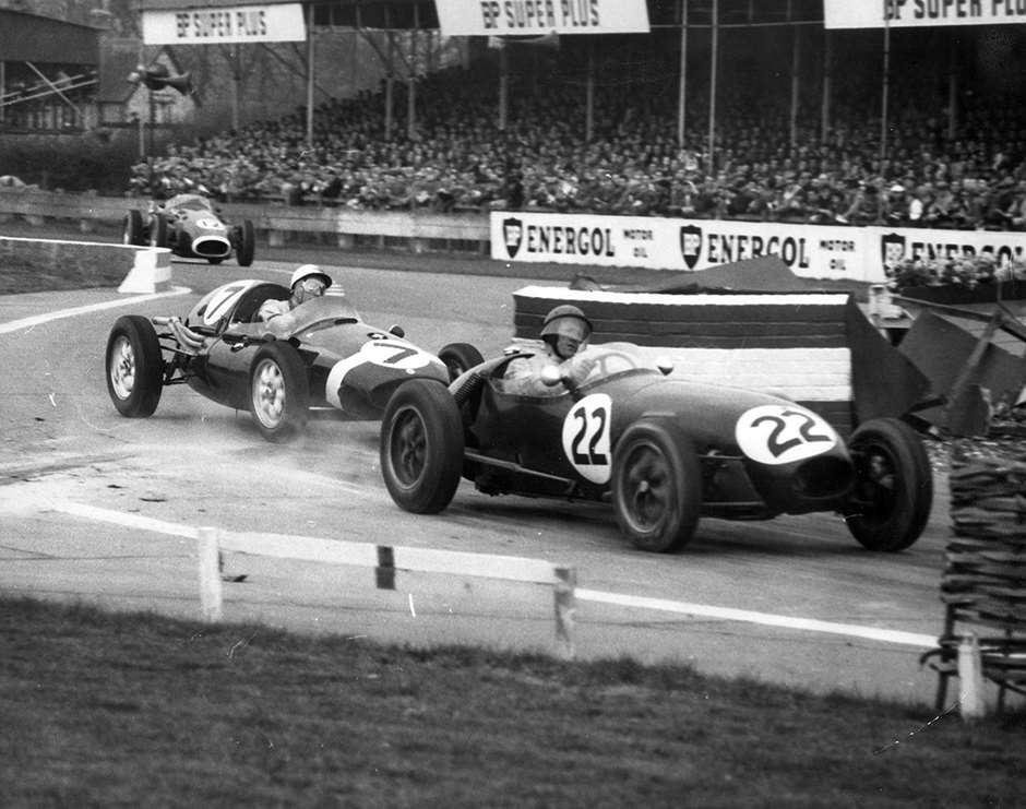 Cliff Allison's Lotus 12 leading Stirling Moss's Walker Cooper in the Goodwood chicane, Easter Monday 1958