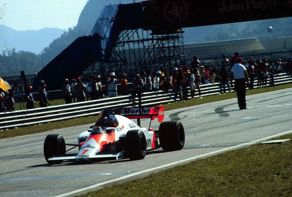 1984 BRAZILIAN GP. Alain Prost, McLaren, raises his arms in victory after winning his debut race for McLaren at the first GP of the season in Jacarepagua. Photo: LAT